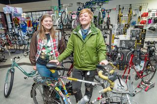 Marcus Larson/News-Register##Haley Winkelman and Lizzy Trickey are back at their hometown bike shop, Tommy's, after riding 10,000 miles through 48 states.