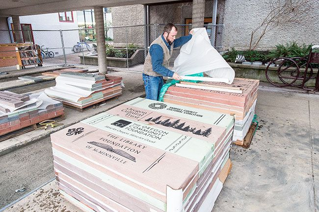 Marcus Larson/News-Register##Rich Moore with Blue Spruce Builders unpacks another palette of specially made bricks for the McMinnville Library.  The bricks will be featured as part of the new library courtyard.