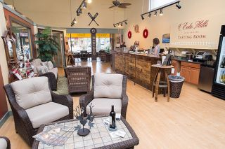 Marcus Larson/News-RegisterThe Eola Hills Wine Cellars tasting room at Third and Evans streets features antique furnishings and decor items that can be enjoyed while sipping in comfort.