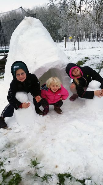 George Bresler##From left to right, Cyprus, 7, Florence, 3, and Daphne, 9, Anderson enjoy the igloo they constructed Wednesday.