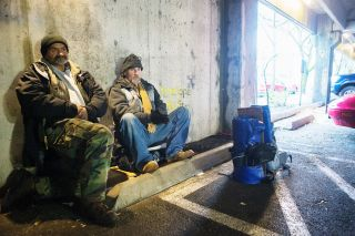 Jason, right, and his 56-year-old street pal, Mark, take an early morning break before heading out to seek aid and comfort from passing motorists. Mark is a former painter and welder from Idaho. The two have been hanging out together since meeting 18 months ago at a local shelter.