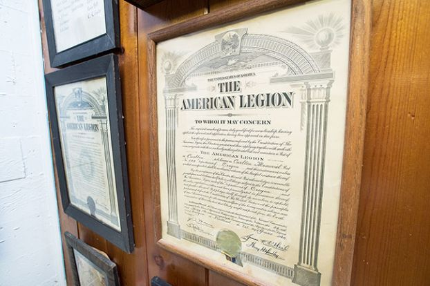 Marcus Larson/News-Registerleft: Important documents, such as the 1948 charter, are posted on the wall of Carlton Memorial Post 173's meeting room.