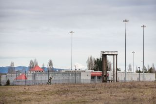 Rusty Rae / News-Register##Gates of the Sheridan federal prison.