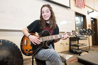 Marcus Larson/News-Register ## McMinnville High School senior Mallory Mead, here with an acoustic guitar in a school practice room, is a member of the jazz band and Twilighters rhythm section. She'll be among the performers at the upcoming Jazz Night fundraiser.