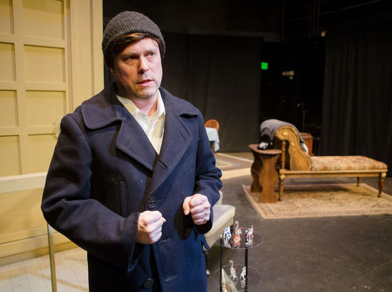 Rockne Roll/News-Register file photo##Tom Wingfield, played by David Bates, delivers his opening monologue during rehearsal for Gallery Theater s production of  The Glass Menagerie,  in January.