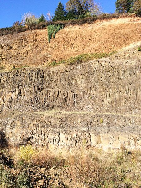 Submitted photo##View inside the Walnut Hill Quarry. The sheer cliff reveals the interior rock formation of the hill. Note the layers of three distinct volcanic events.