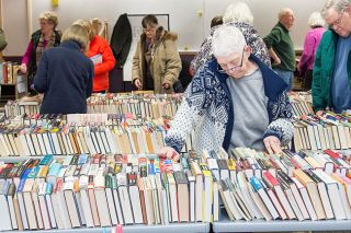 Marcus Larson/News-Register##Ruth May browses the titles at the Friends of the McMinnville Public Library book sale. The sales are held the second Saturday of alternate months.