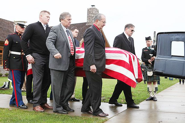Rockne Roll/News-Register##Family members of Gunnery Sgt. Percy Brandon escort his casket to a waiting hearse following a funeral service at Evergreen Chapel in McMinnville on Wednesday, Jan. 20.