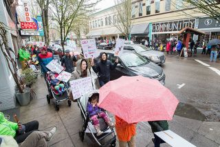 Marcus Larson/News-Register##About 1,000 people marched in downtown McMinnville Saturday in support of women, equality for all and other issues.
