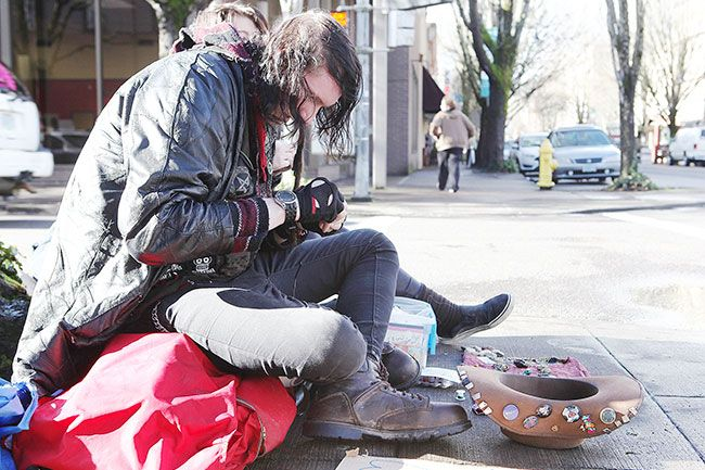 Rockne Roll / News-Register##Christian Hall crafts jewelry on the sidewalk at Northwest Third and Davis streets in McMinnville on Friday, Jan. 22. Volunteers will count homeless people in Yamhill County on Wednesday.