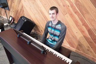 Marcus Larson/News-Register##Cody Pennington loves music — he plays, composes and incorporates music into his activities at the Amity Christian Church. He was named Yamhill County DAR's good citizen of the year.