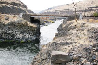 Image: Lostwagonman/Wikimedia##At the spot in the Deschutes River where this bridge is today, members of Stephen Meek's wagon train built a pulley system to get people and wagons across the river.