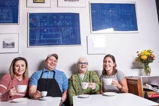 Rusty Rae / News-Register##Business members of Trade Street Commons relax with coffee from the Common Cup. From left are Sandra Villasenor of Piked and Posh; Francisco Sanchez of Tacos Burros; Erin Rainey of the Rain Flower; and Jeanne Coelho of Common Cup, manager of the facility.