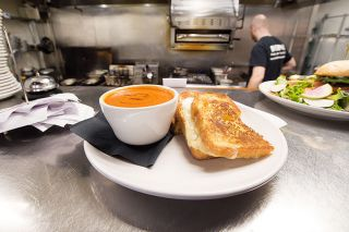 Marcus Larson/News-Register##A grilled cheese sandwich and tomato soup — the Melt Down special from 2017, which has become a permanent part of The Diner's menu. The restaurant continues to contribute a portion of the sales, as well.
