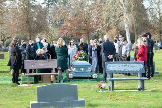 Marcus Larson/News-Register##Family members and friends of Monty Fergus say goodbye during a ceremony at Evergreen Memorial Park. The family held a small gathering in their church, but more people could attend the outdoor service.