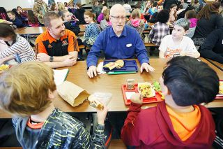 Rockne Roll / News-Register##State Rep. Ron Noble, R-McMinnville, enjoys lunch and conversation with Yamhill-Carlton Intermediate School students.