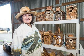 Marcus Larson/News-Register ## Mary Mayor uses found objects to embellish her whimsical birdhouses. Shells, nuts, corks and bits of moss are favorite materials.
