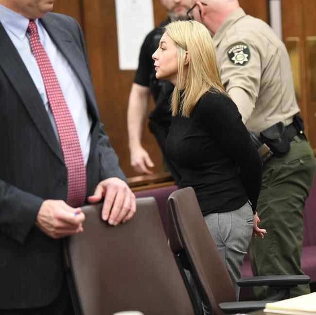 Rusty Rae/News-Register##A handcuffed Jennifer Weathers is led out of the courtroom and to the Yamhill County Jail where she will serve time.
