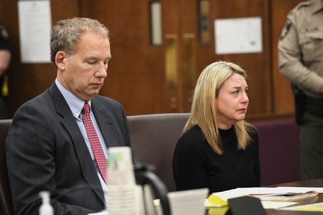 Rusty Rae/News-Register##Jennifer Weathers is seated with her attorney, Walter Todd of Salem, during Tuesday morning s plea and sentencing hearing.