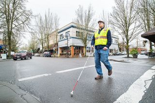 "Marcus Larson/News-Register ## Josh Alvey has been learning to navigate the downtown area with a white cane. A condition called retinitis pigmentosa has caused a slow loss of eyesight since he was a child. He became legally blind by his early 20s; now, at 41, he has less than 5% of his total vision — ""like looking through pinholes,"" he said."