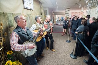 Marcus Larson/News-Register##Joel Kiff on banjo, Dave Sumner on guitar, and Rob Higgins of the Yamhillbillies band serenade guests with country music as they arrive at the Mayor s Ball.