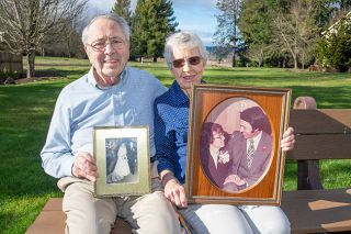 Marcus Larson/News-Register##Bernie and Roz Turner show photos from their wedding in 1952 and their 25th anniversary in 1977. In January, they celebrated 69 years of marriage and telling each other  I love you  many times a day.