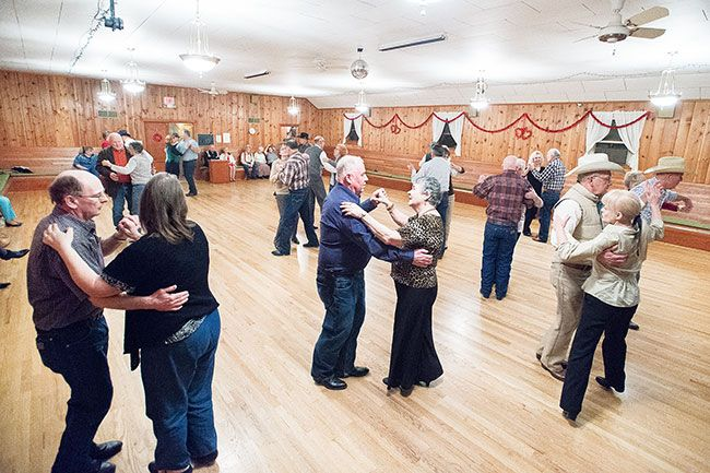 Marcus Larson/News-Register##Ralph Bowdle and Jackie Dornon, center, and other dance to country music during a Friday night get together at the Grange.