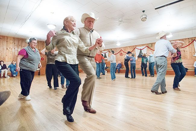 Marcus Larson/News-Register##Cristy Carlson and Joe Meissner make their way around the dance floor at the McMinnville Grange. Dancers say they like the venue because of the beautiful floor and the friendly, family atmosphere.