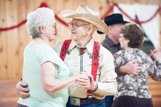 Marcus Larson/News-Register##Stephen and Gladys (Pyne) Cone slow dance during the weekly get-together at the Grange. They met there May 2, 2014, and married May 2, 2015 -- one of many couples who found romance at the Grange.