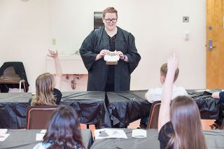Marcus Larson/News-Register##Ginevra Weasley, a professor of muggle studies at Hogwarts School of Witchcraft and Wizardry, leads a class at the McMinnville Community Center. When not teaching potions and spells, she goes by the name Lydia Driver.