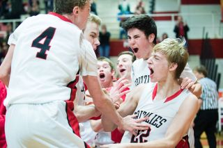 Marcus Larson/News-Register##McMinnville sophomore Aaron Baune (22) celebrates the Grizzlies  77-75 victory over McKay Tuesday evening at The Furnace.
