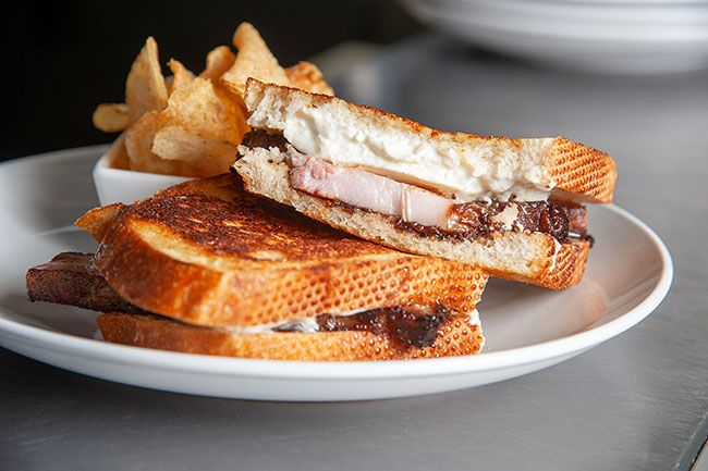 Rusty Rae/News-Register##Horse radish chef Mayy Zangara serves up the PB&JK, which stands for pork belly, burrata cheese, fig jam and  we re not kidding.