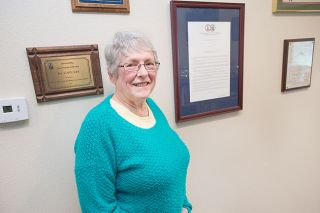 Marcus Larson/News-Register##Gail Lee, pictured here in her McMinnville home with some of the many awards she's won as an agronomist, extension agent and educator.