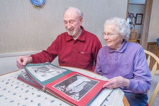 Marcus Larson/News-Register##Stan and Virginia de Stwolinski look over their album of wedding photos.