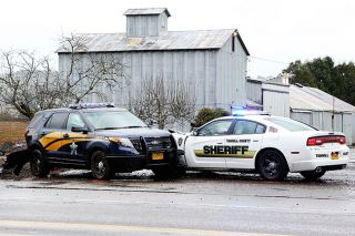 Rockne Roll/News-Register##A pair of law enforcement vehicles sits on the shoulder of Oregon Highway 18 near Riverbend Landfill outside McMinnville after colliding with one another while pursuing a suspect.