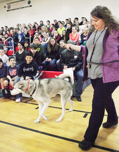 Rockne Roll/News-Register##Amity Middle School teacher Mary Motocha leads Lorainne Temple s dog Willow in to a presention to Amity Middle School students on Tuesday, Feb. 16.
