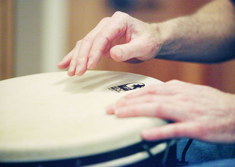 News-Register file photo##Rob Schulman plays a djembe, a type of goblet-shaped drum originating in West Africa.