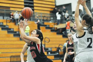 Robert Husseman/News-RegisterMcMinnville senior Makayla Khatewoda (20) puts up a shot against West Salem on Friday.