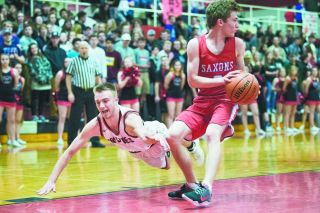 McMinnville s Parker Spence goes flying after a loose ball during the Grizzlies  game with South Salem, Friday.