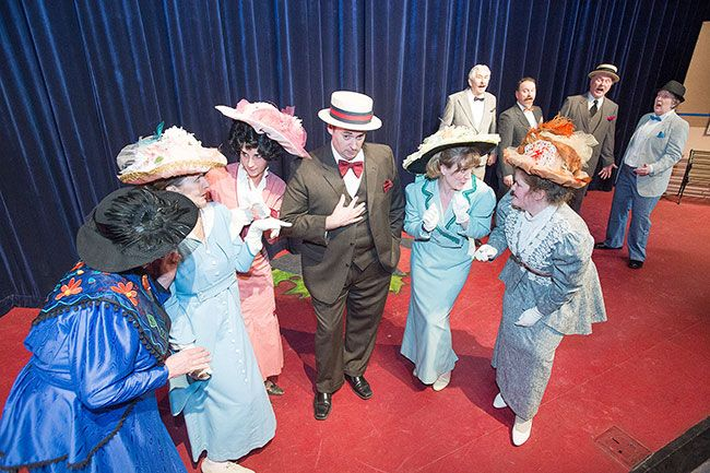 Marcus Larson / News-Register##Harold Hill (Adam Ewing) encourages the River City women to gossip in Gallery Theater s production of  The Music Man.
