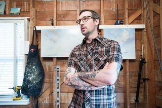 Marcus Larson/News-Register##Zach Hixson, pictured  in the workspace at his McMinnville home, is planning to open a new studio on Fourth Street next week.