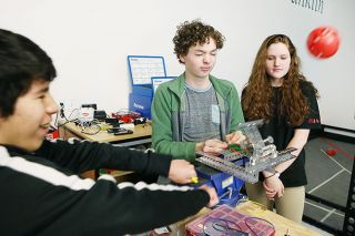 Rockne Roll/News-Register##From left, McMinnville robotics students Jose Flores, Prescott Benner, Laura Denney, work on a design for a plastic ball launcher at Evergreen Space Museum on Monday, Feb. 20.