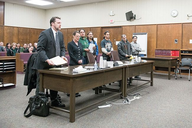 Rusty Rae / News-Register##Attorney Steve Cox and estate representative Grace Snidow appear in court along with Hendricks Road residents Brian Suverly, Jack Pettit, Patrick O Rourke, Wayne Gross and Marshall Gross.