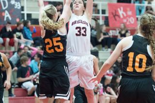 Marcus Larson/News-Register##Audrey McMillan (33) scored 17 points to lead the Grizzlies to victory over Sprague on Tuesday night.