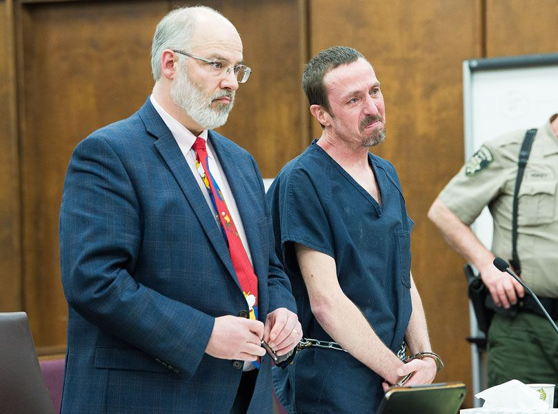 Marcus Larson/News-Register##Timothy McCready, flanked by his attorney, Mark Lawrence of McMinnville, will spend the next 13 years in prison.