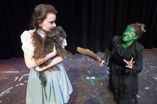 Marcus Larson/News-Register##Dorothy (Molly Janssen) and her dog Toto (Muffin Terry) are confronted by the Wicked Witch of the West (Lesli Lucier), who demands Dorothy's ruby red slippers.