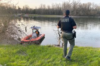 Submitted photo##Rescuers search Wednesday for a vehicle that went into the Willamette River near the Wheatland Ferry. The search resumed Thursday morning.
