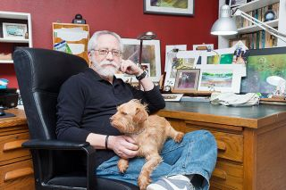 Marcus Larson/News-Register##Dan Homeres often paints in his home office, which he also uses when writing poetry and fiction. Zelig, a Cairn terrier-dachshund mix, is his assistant.