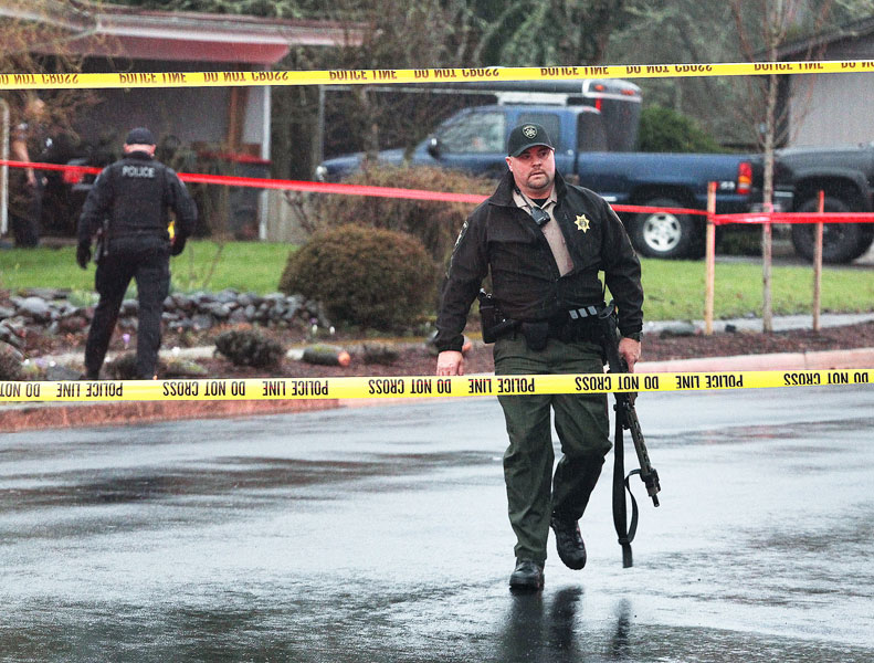 Rockne Roll/News-Register##A Sheriff s deputy working at the scene where a woman was killed and a man injured Wednesday evening.