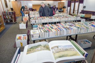 Marcus Larson/News-Register ## Mike Graham  and others browse the large selection of books during a recent book sale in the Carnegie Room at the McMinnville Library.